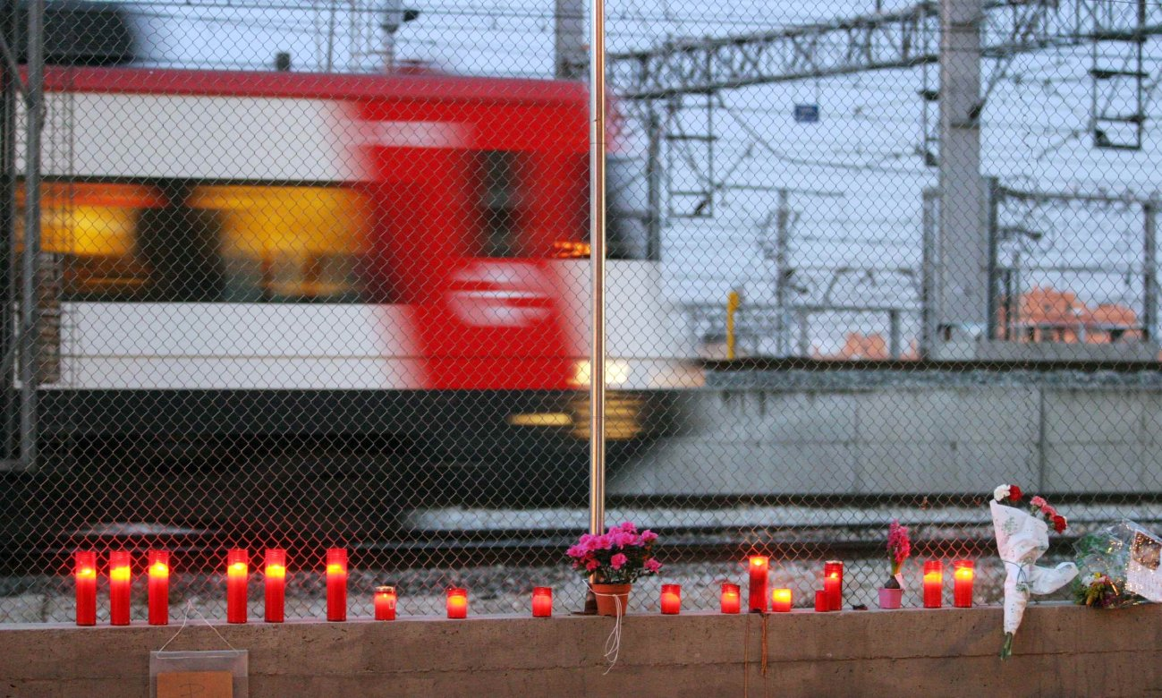 A woman lays flowers for the victims of Madrid's March 11, 2004 train bombings